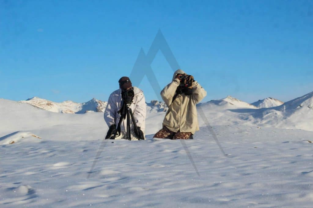 Pamir photographing in the snowy mountains