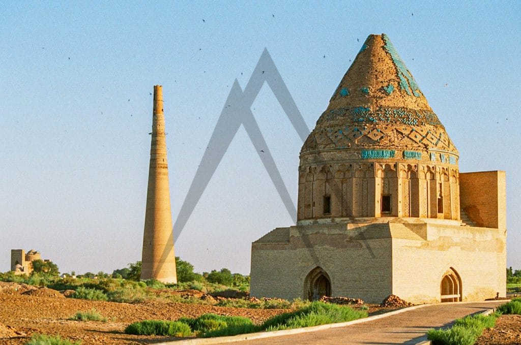 Sultan Tekesh mausoleum with Timur Qutlugh minaret in the background in Konye Urgench