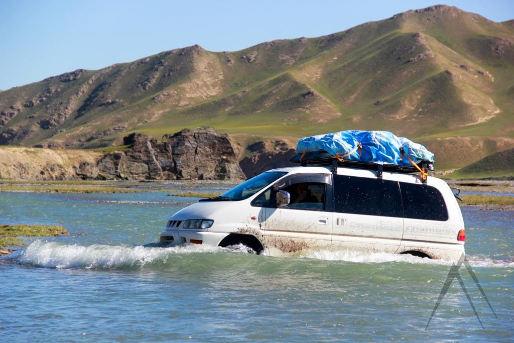 Off road crossing river in Kyrgyzstan with car