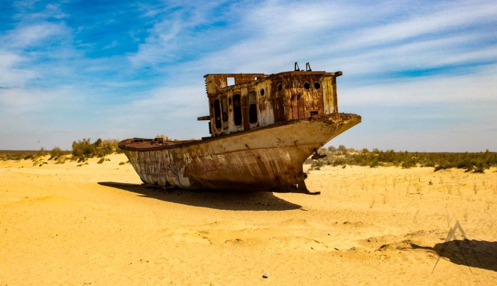 A rusty ship at the bottom of the Aral sea which is now a desert